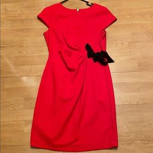 Red ruched dress with black bow tie